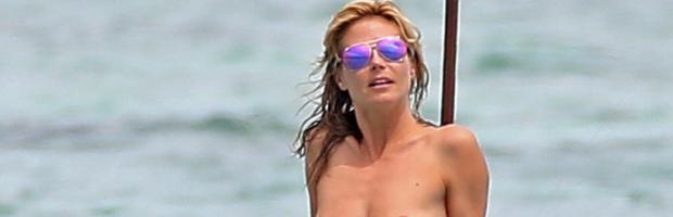 heidi klum topless in cool shades at beach 1425