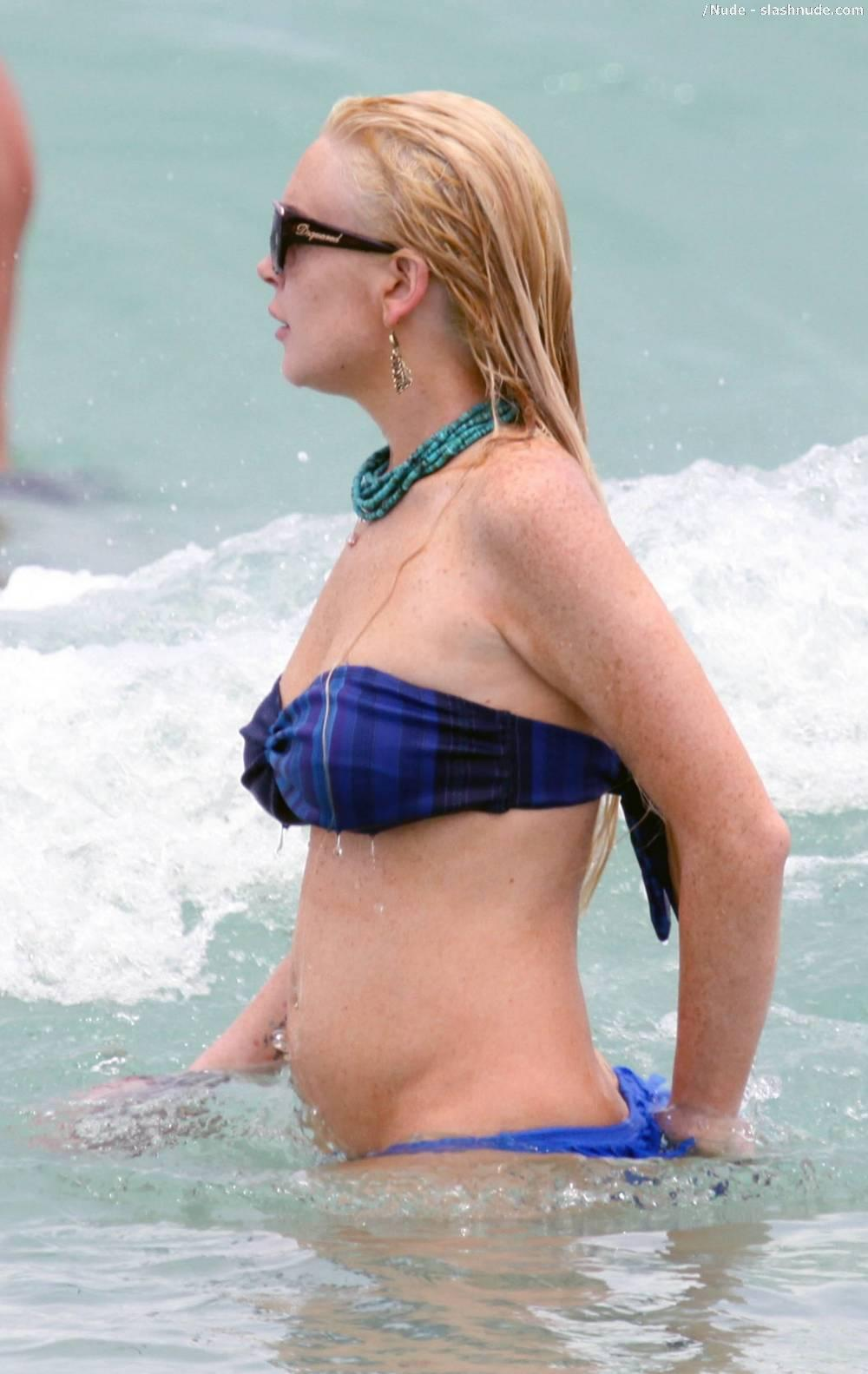 Lindsay Lohan Breasts Slip Of Her Bikini In Miami 11