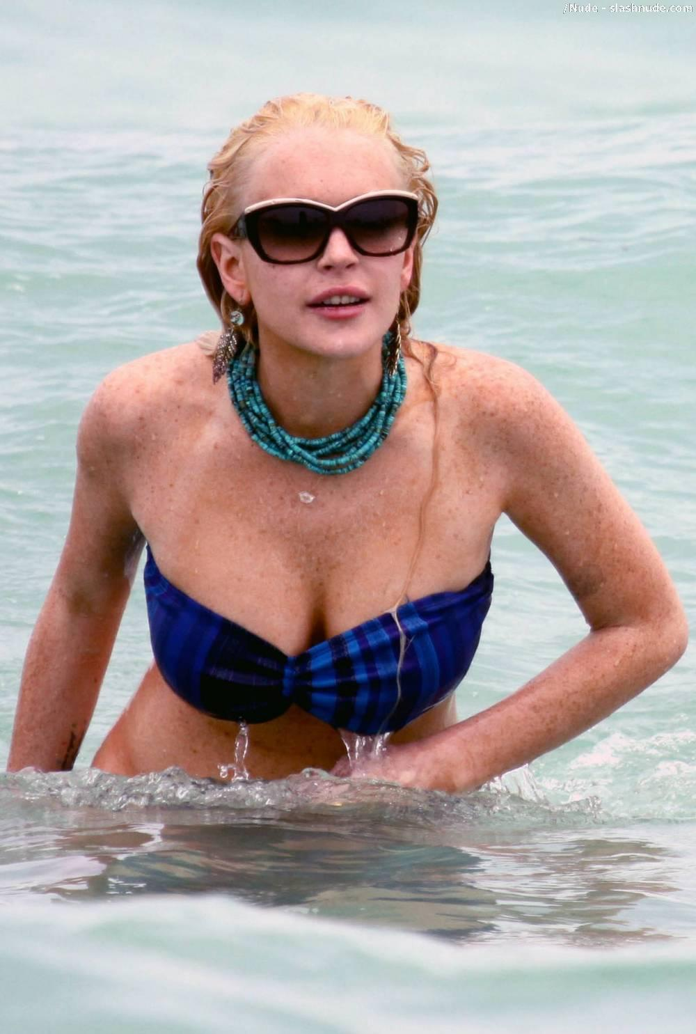 Lindsay Lohan Breasts Slip Of Her Bikini In Miami 3