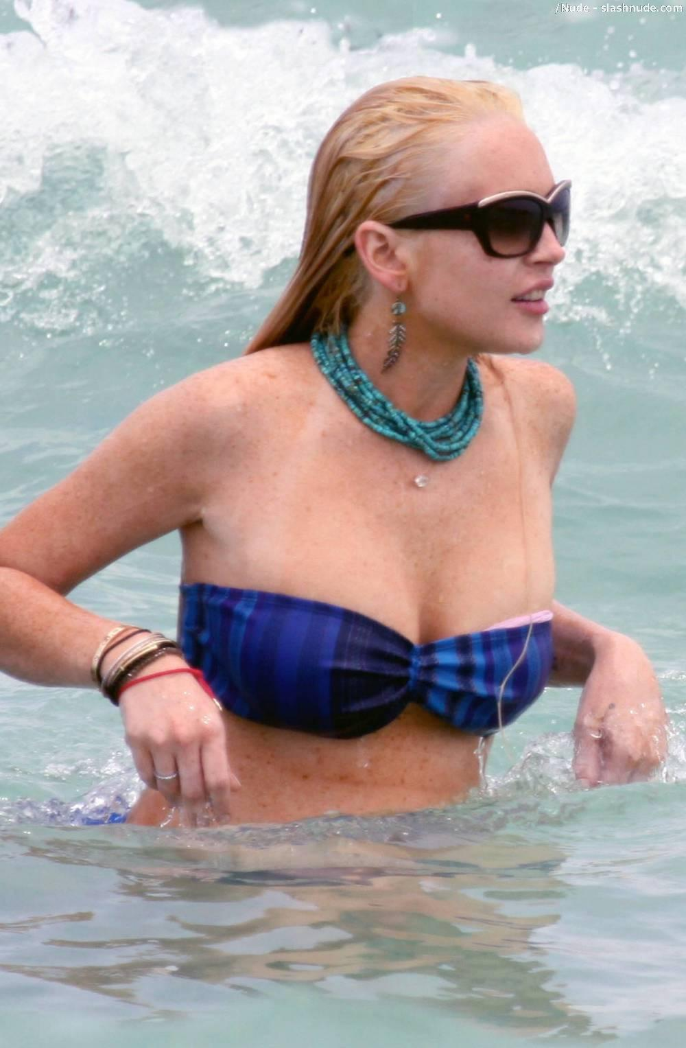 Lindsay Lohan Breasts Slip Of Her Bikini In Miami 4