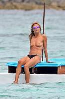 heidi klum topless in cool shades at beach 1425 3