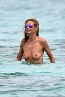 heidi klum topless in cool shades at beach 1425 8