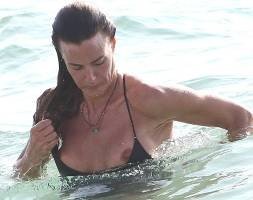kelly bensimon nipples slip out of top at beach 6553 3