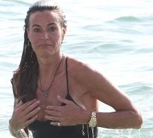 kelly bensimon nipples slip out of top at beach 6553 4