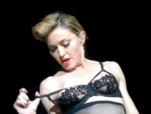 madonna pulls down bra to expose her breast in istanbul 2989 2